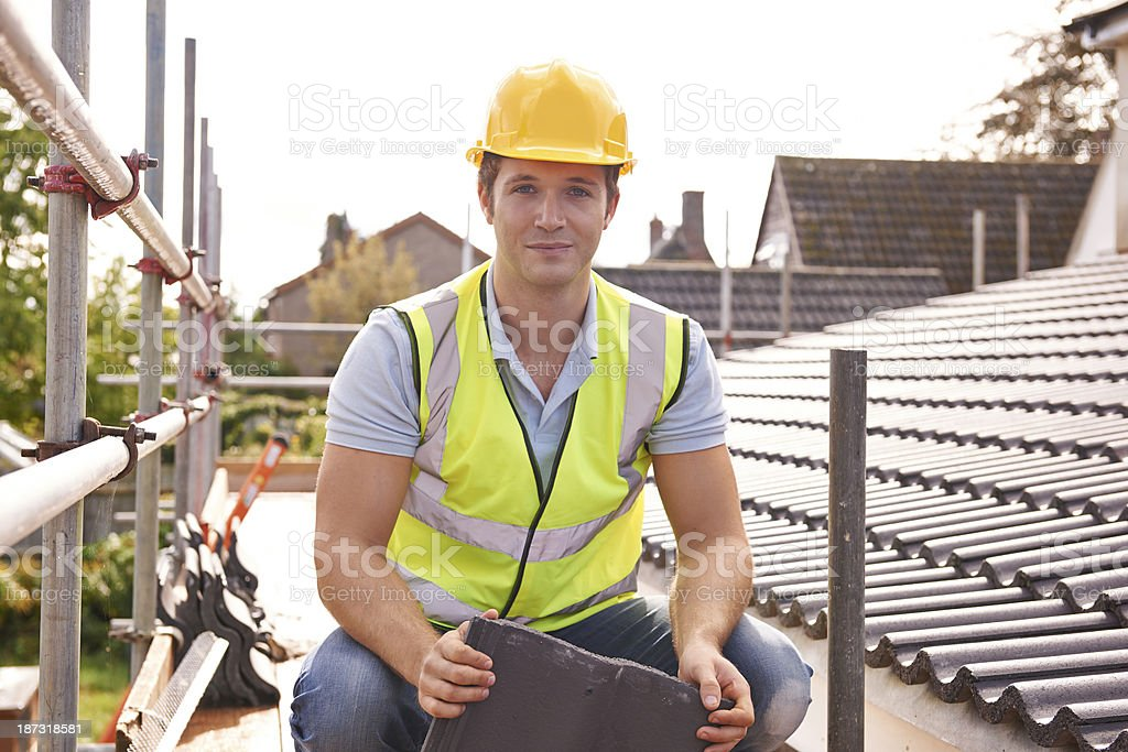 Builder Working On Roof Of New Building stock photo