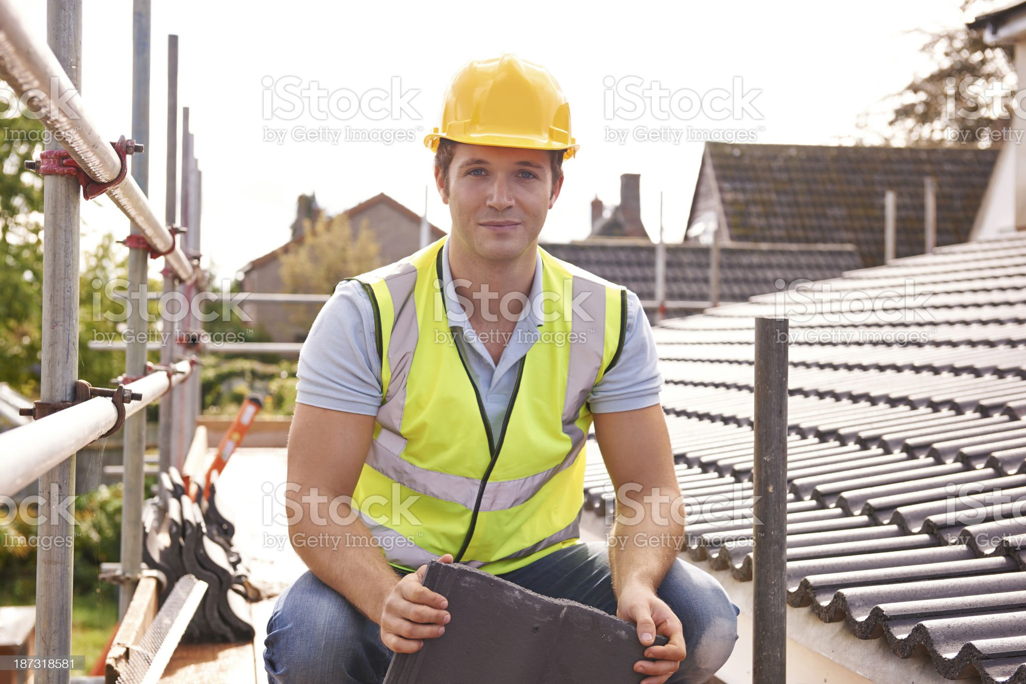 Builder Working On Roof Of New Building royalty-free stock photo
