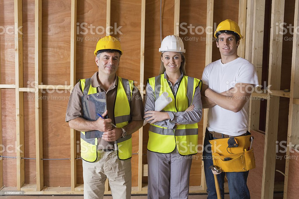 Builders and architect smiling stock photo