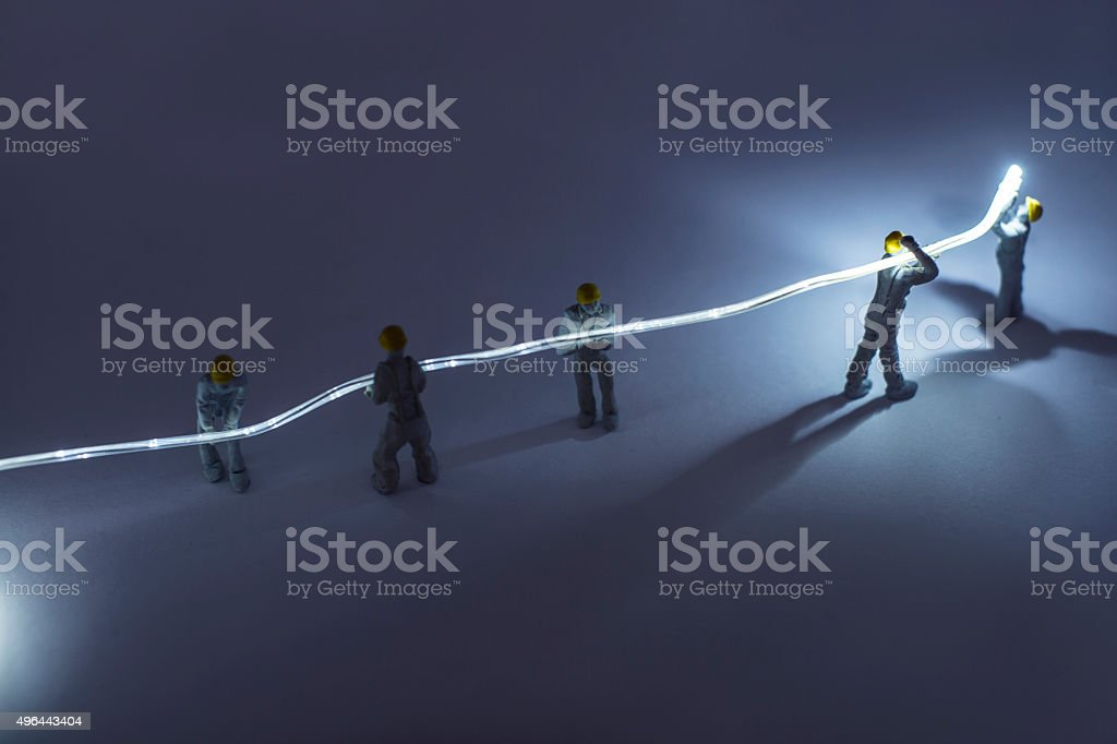 Builders installing fibre optic stock photo