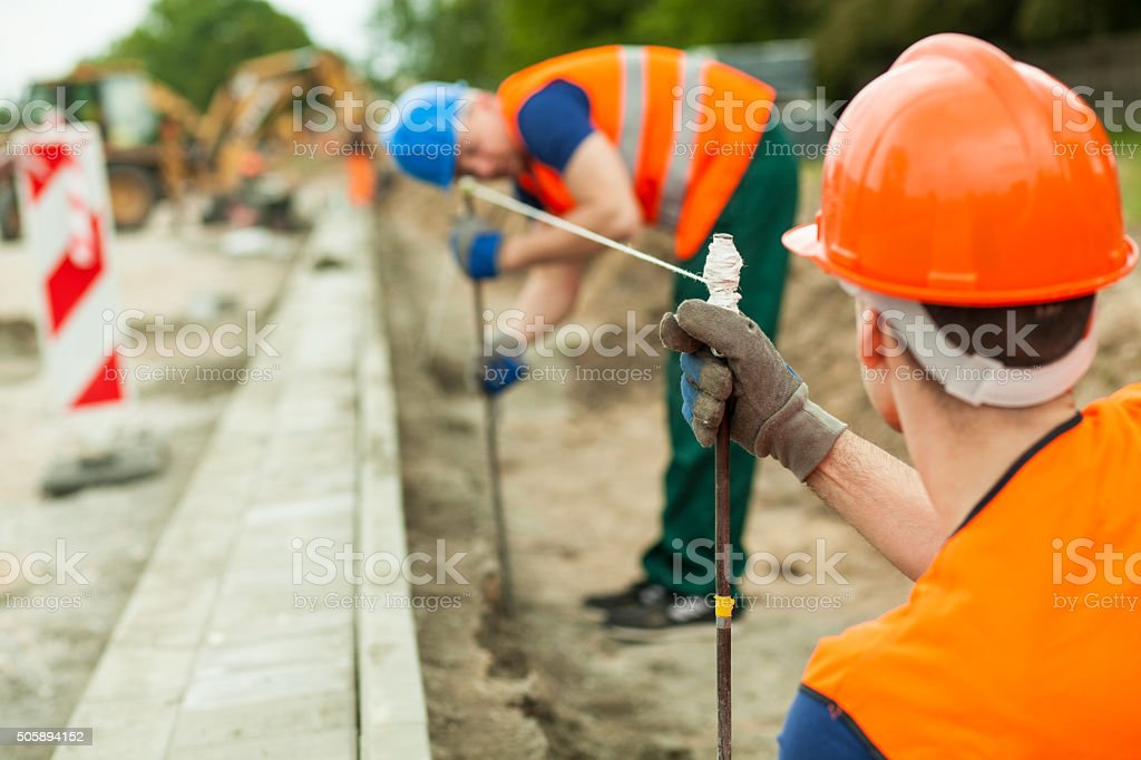 Builders working along stock photo