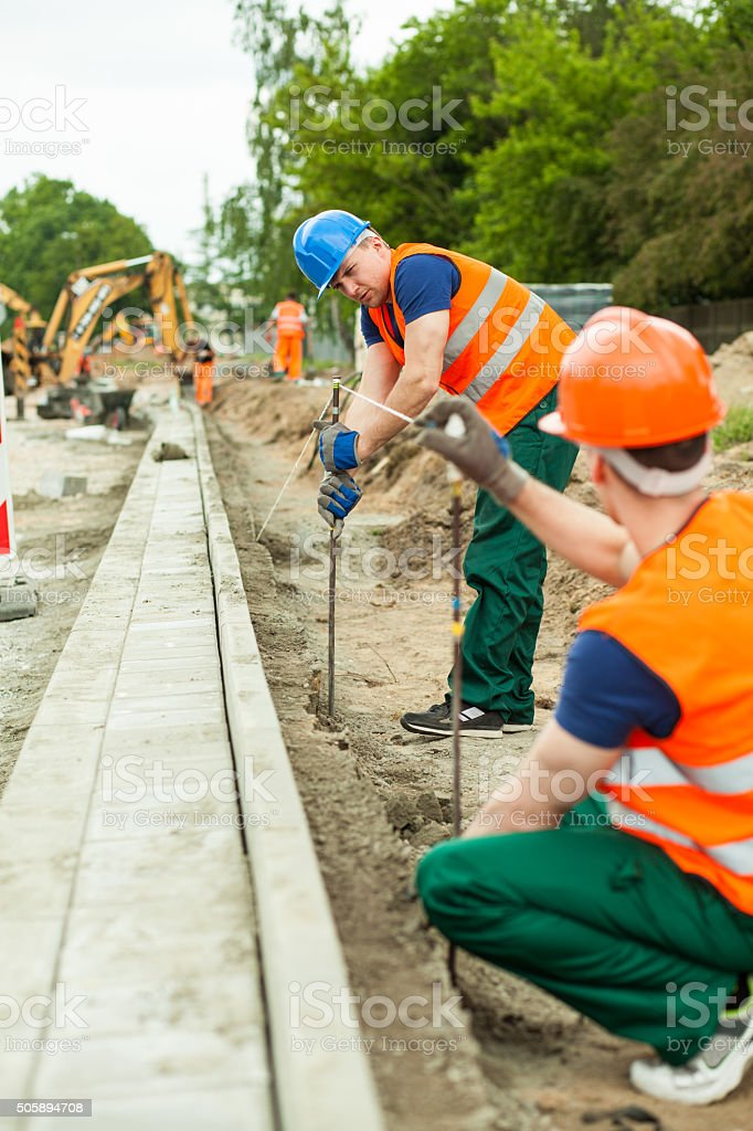 Builders working together stock photo