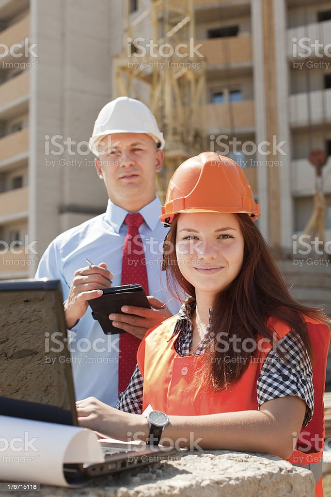 builders works at construction site royalty-free stock photo