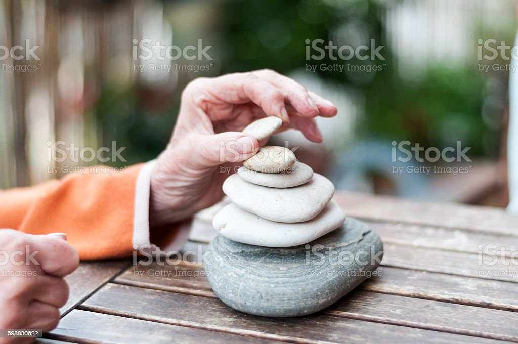 Building a cairn stock photo