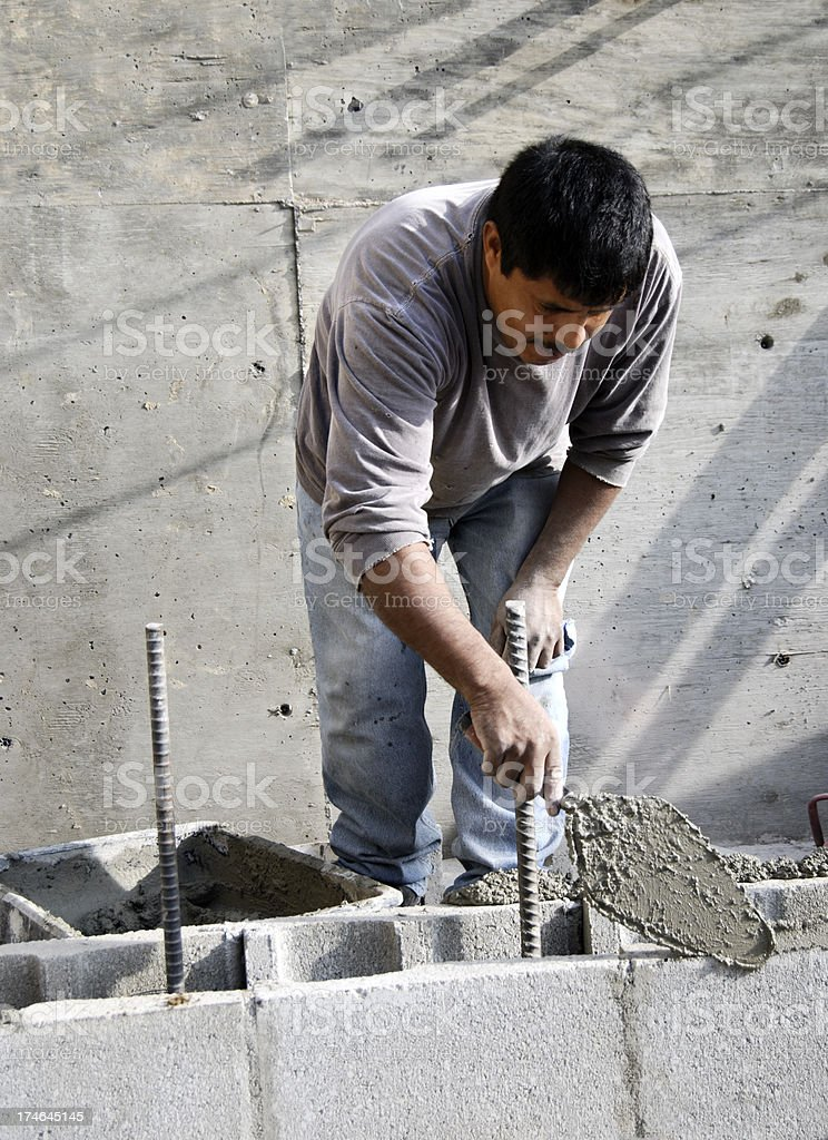 Building a concrete block wall royalty-free stock photo