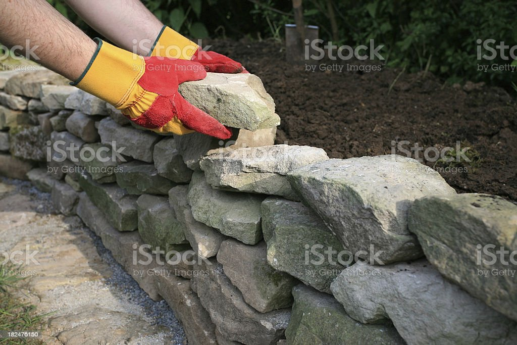 Building a drystone wall royalty-free stock photo