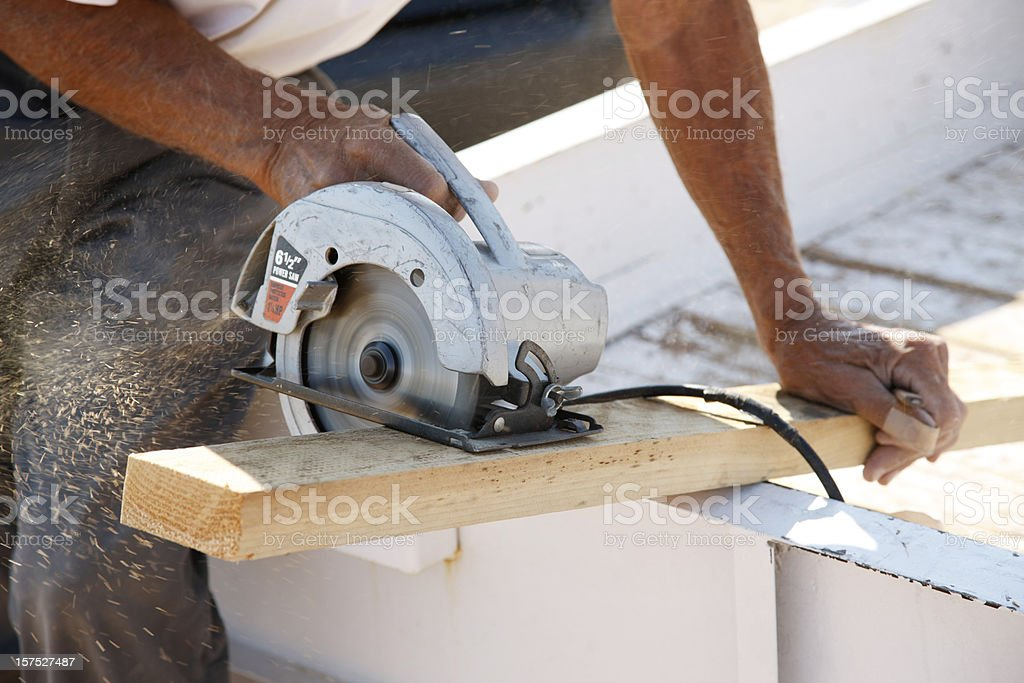 Building a Fence Series - Cutting Board with Circular Saw royalty-free stock photo
