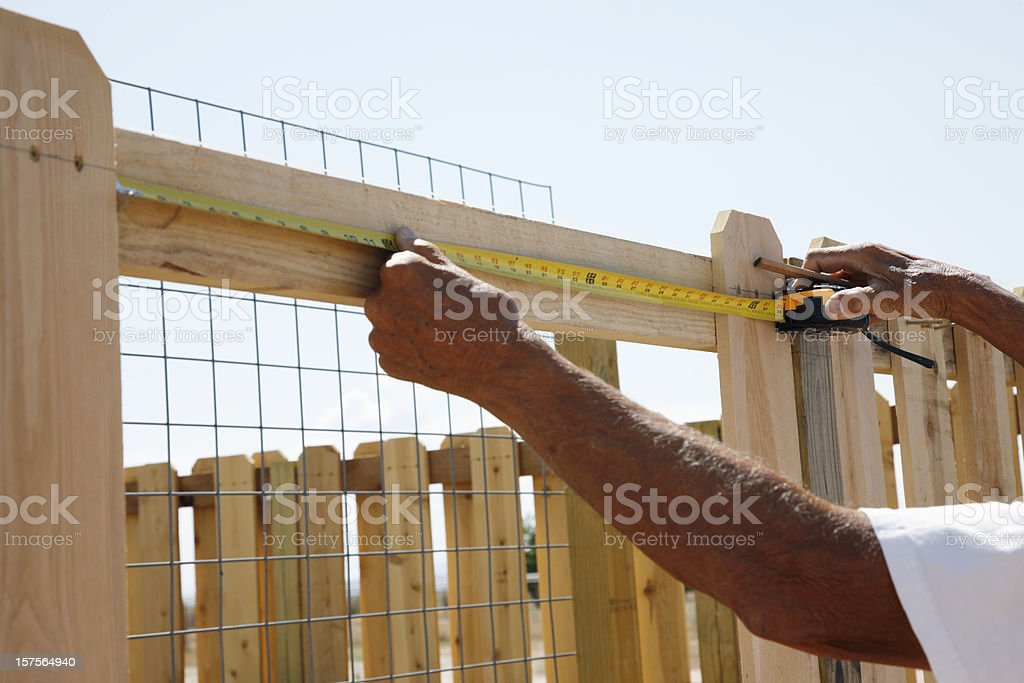 Building a Fence Series - Measuring royalty-free stock photo