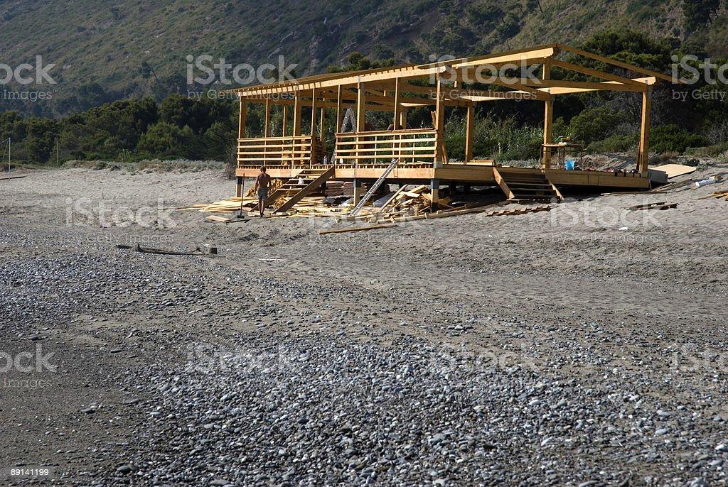 Building a house on the beach stock photo
