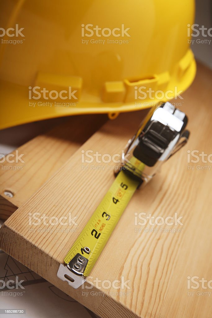 Building a House with Blueprints stock photo