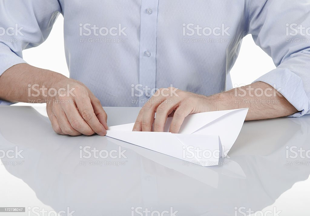 Building a paper plane stock photo