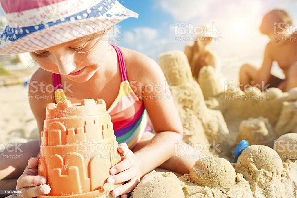 Building a sand castle stock photo