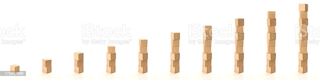 Building a tower of wooden blocks from 1 to 10 stock photo