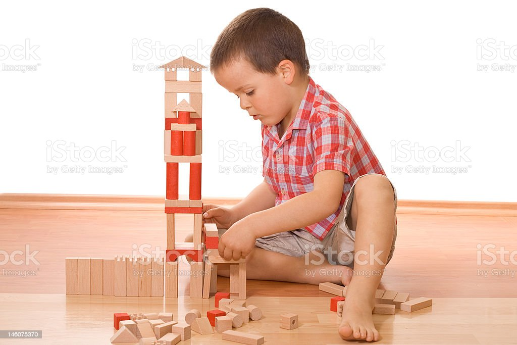 Building a wooden block castle royalty-free stock photo