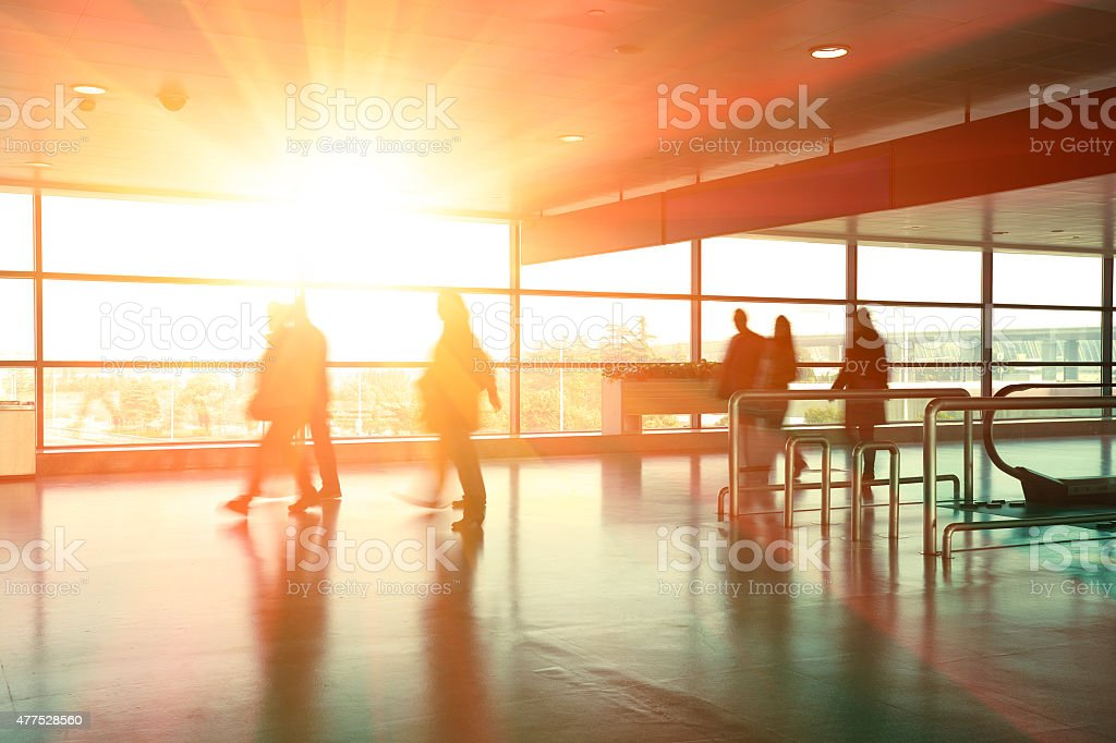Building aisle interior glass wall of windows in hurry people stock photo