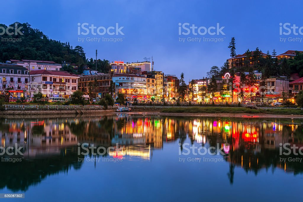 building along lake in sapa city stock photo