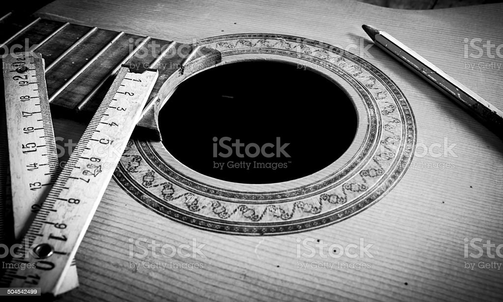 Building an acoustic guitar stock photo
