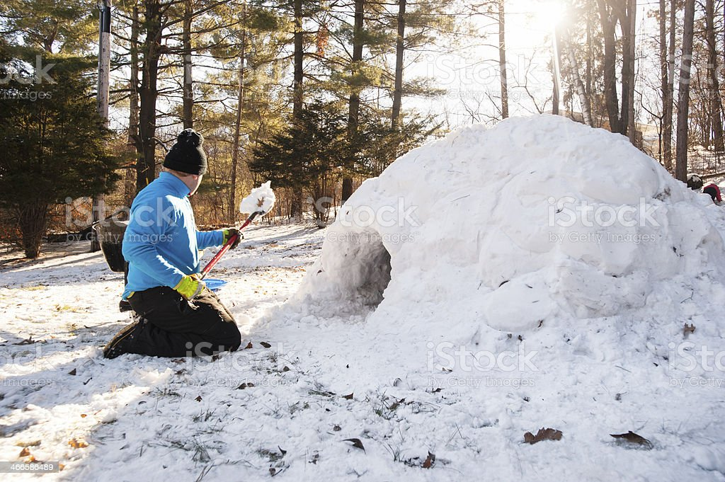 building an igloo stock photo