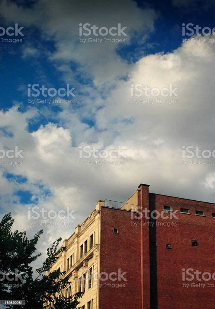 Building and clouds stock photo