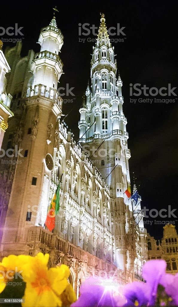 Building and flowers on Grand Place square in Brussels stock photo