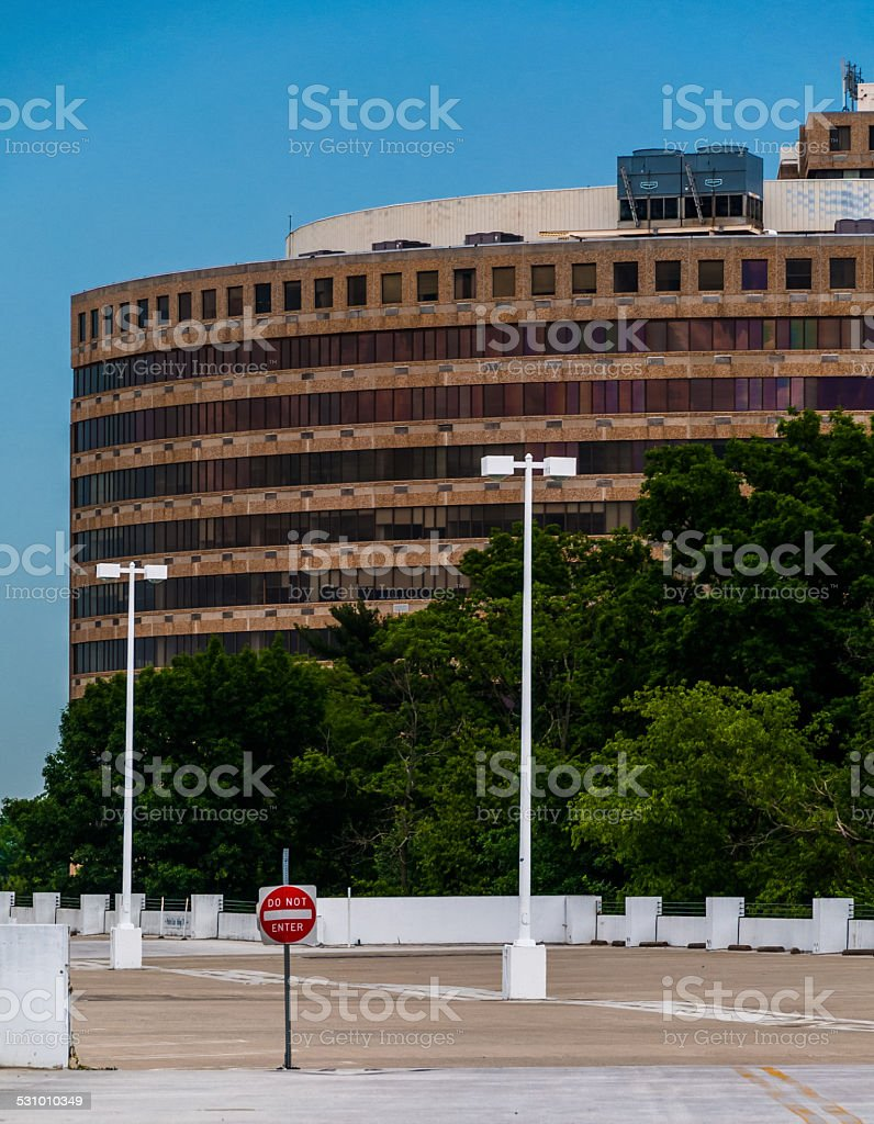 Building and top level of parking garage in Towson, Maryland. stock photo