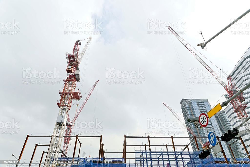 building and towercrane stock photo
