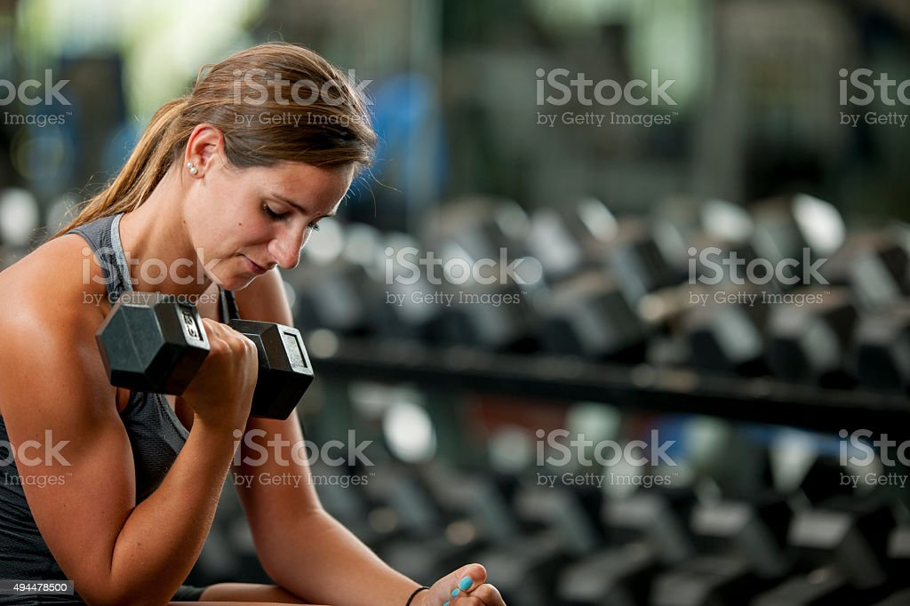 Building Arm Muscles With Free Weights stock photo