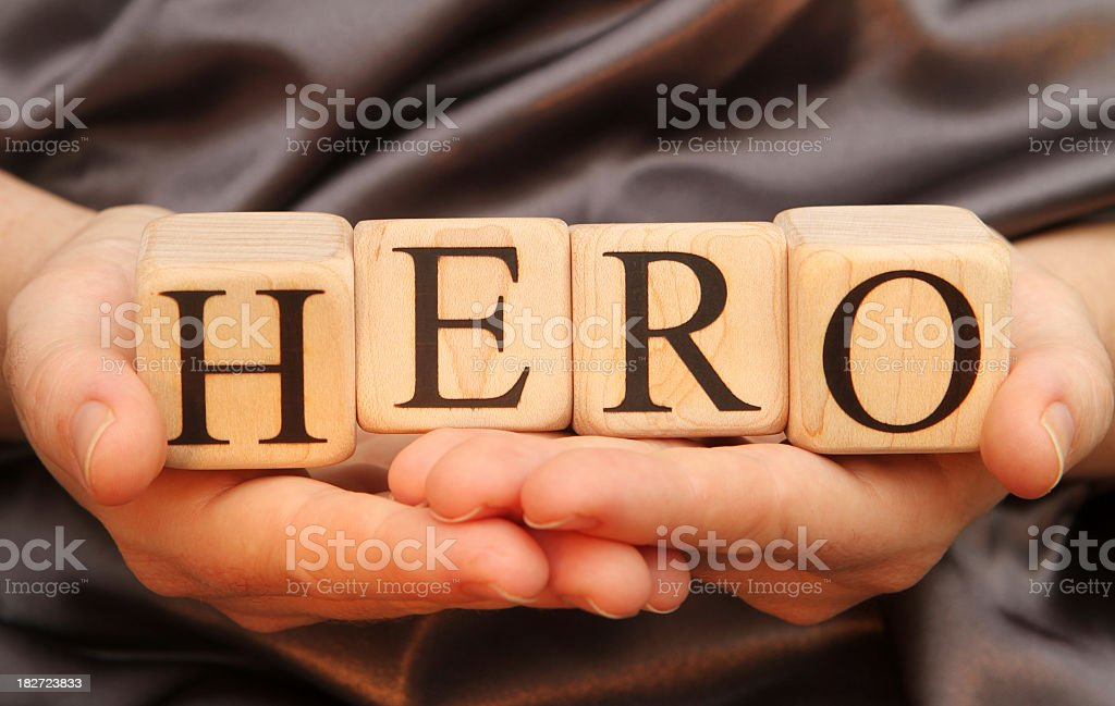 Building blocks spelling out the word hero stock photo