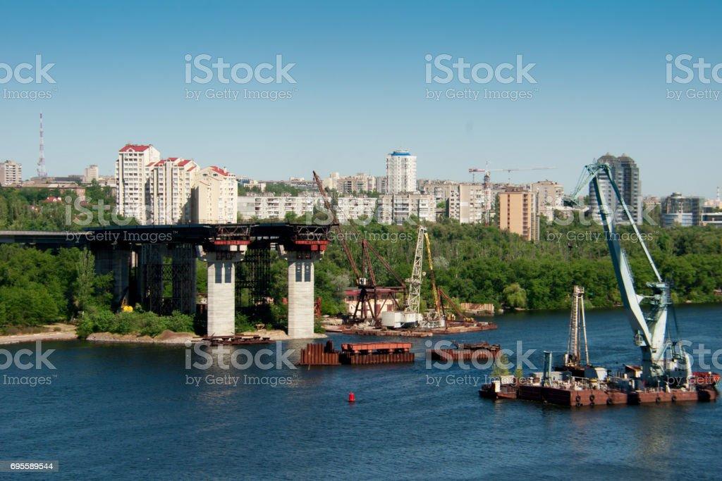 Building bridges across the river stock photo