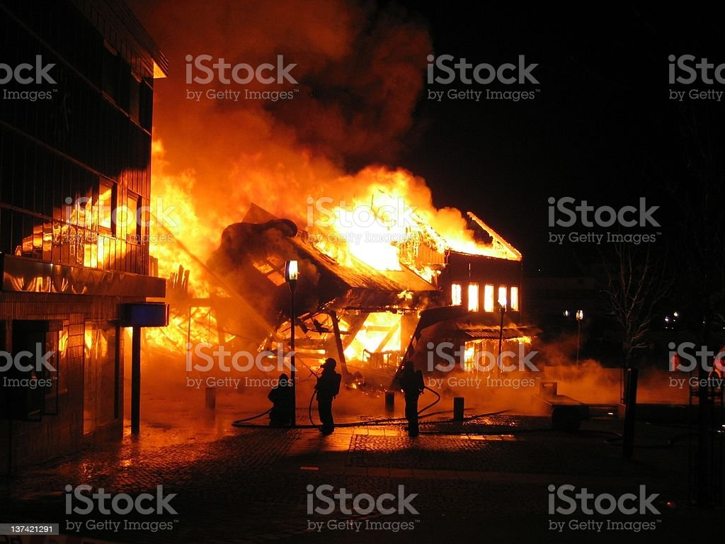Building burning in large extension at night royalty-free stock photo