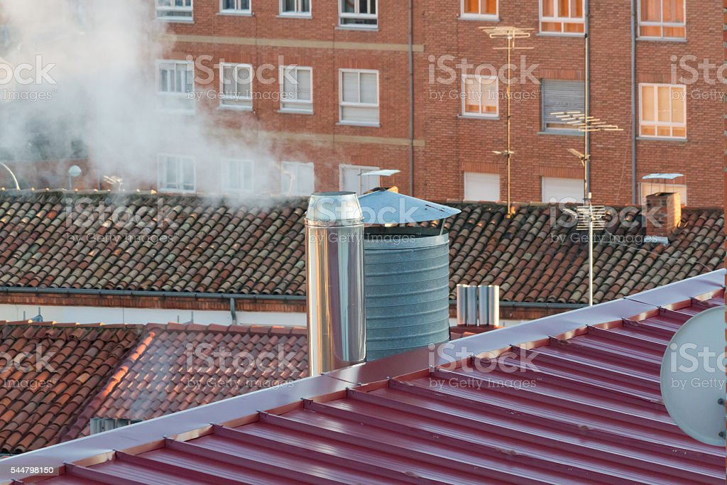 Building chimneys on the roofs - Chimeneas de Edificios stock photo