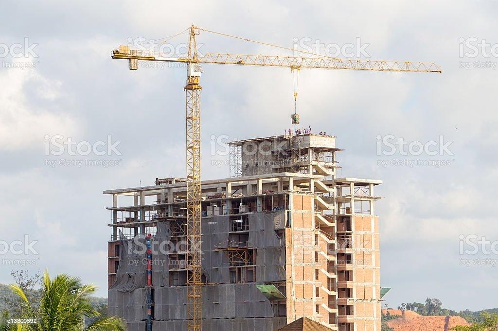 building construction crane on city background stock photo