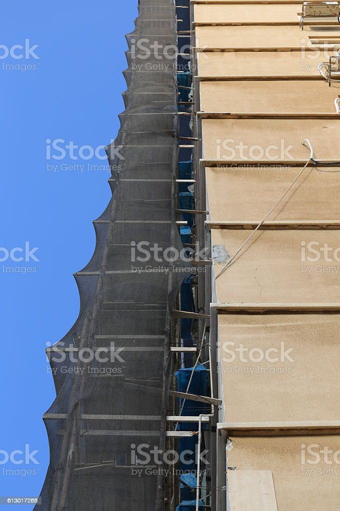 Building Construction with Pipe Staging in a Clear blue Sky. stock photo