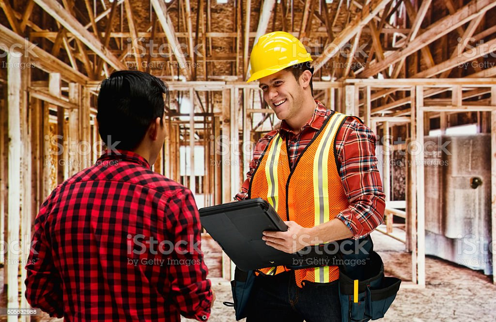 Building contractor discussion with customer stock photo