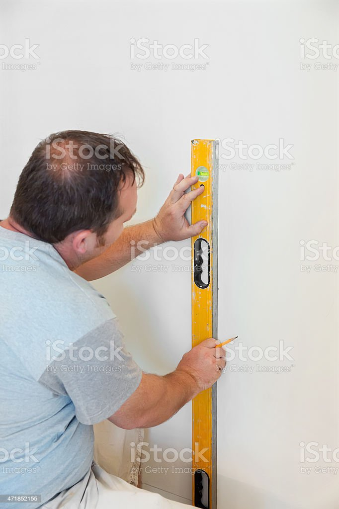 Building Contractor measuring with level royalty-free stock photo