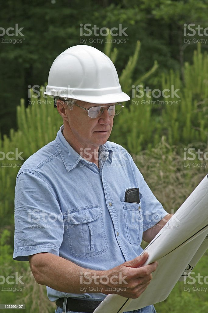 Building Contractor or Architect studying blueprints royalty-free stock photo