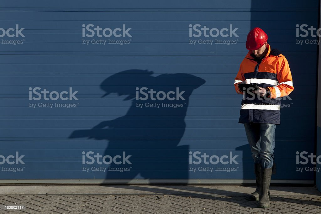 Building contractor working on his ipad. royalty-free stock photo
