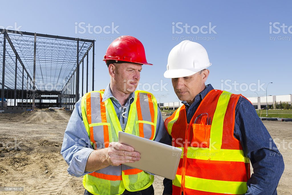 Building Contractors and Computer royalty-free stock photo