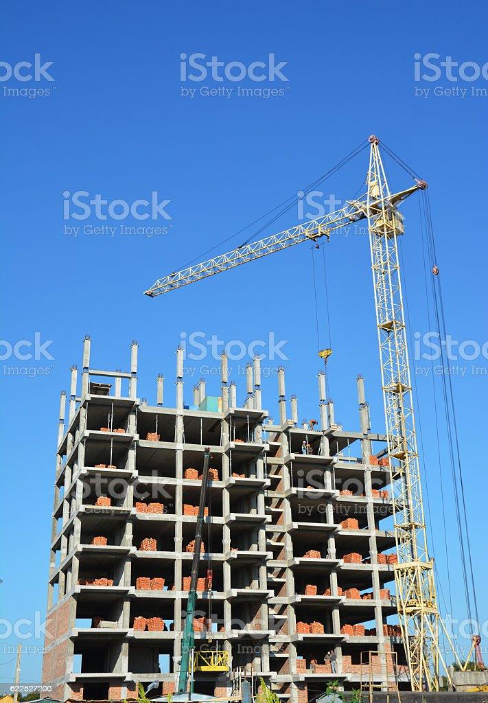 Building cranes on construction site stock photo