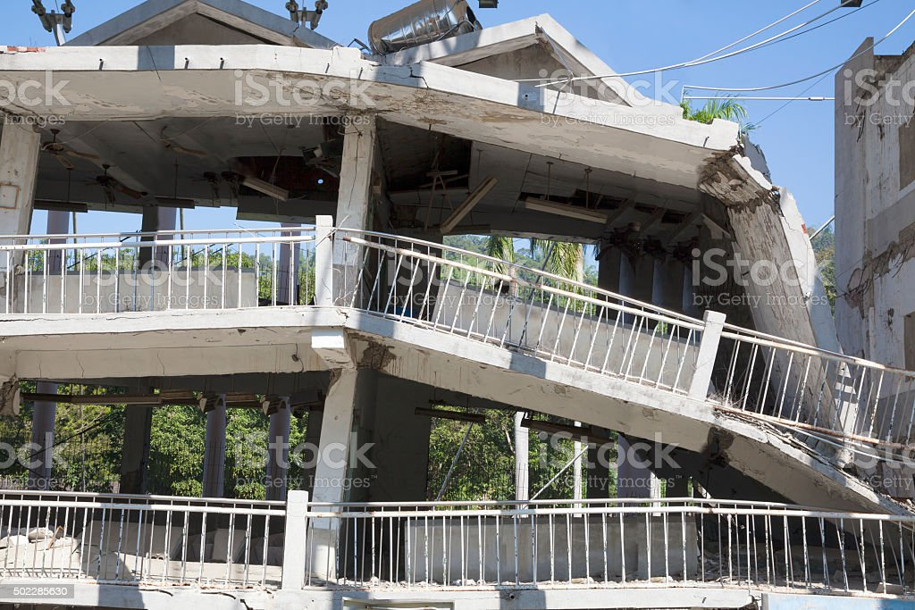 building destroyed during the earthquake stock photo
