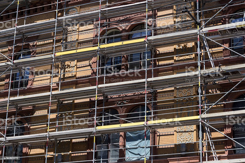 building facade with scaffolding - construction site stock photo