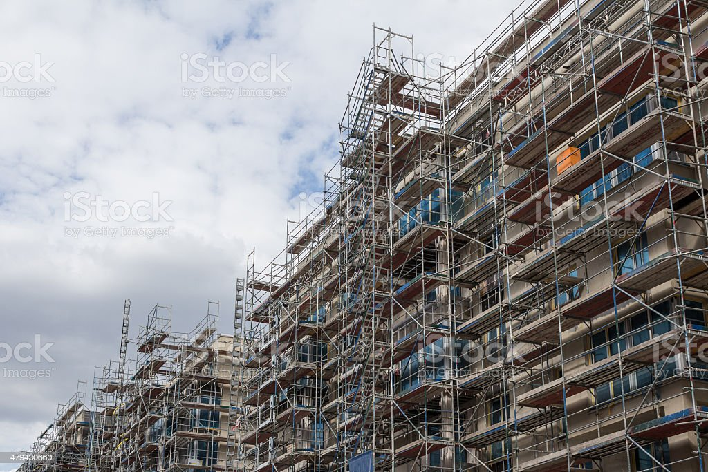 building facade with scaffolding - constructuion site stock photo
