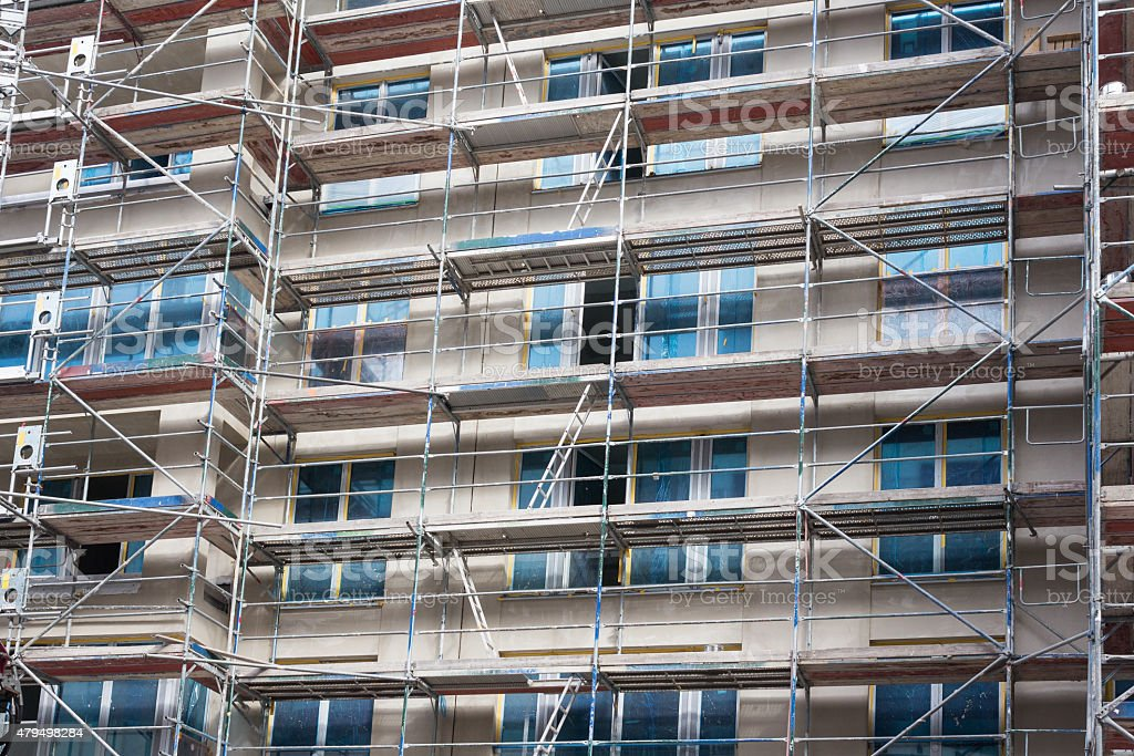building facade with scaffolding - constructuion site stock photo
