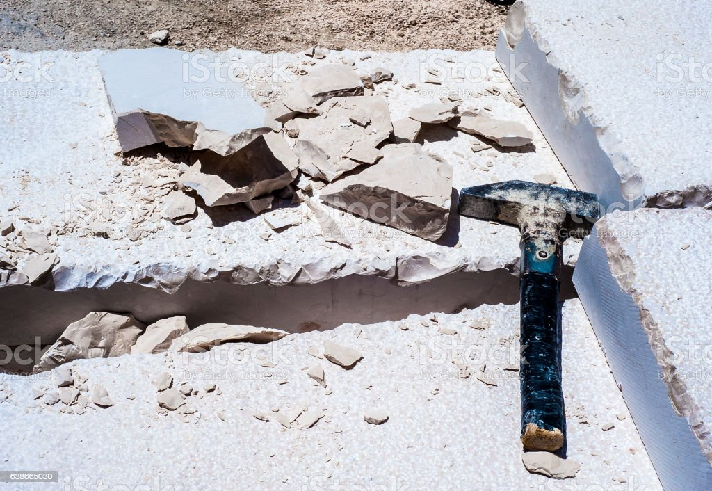 Building hammer, pile of limestone slabs carved stock photo