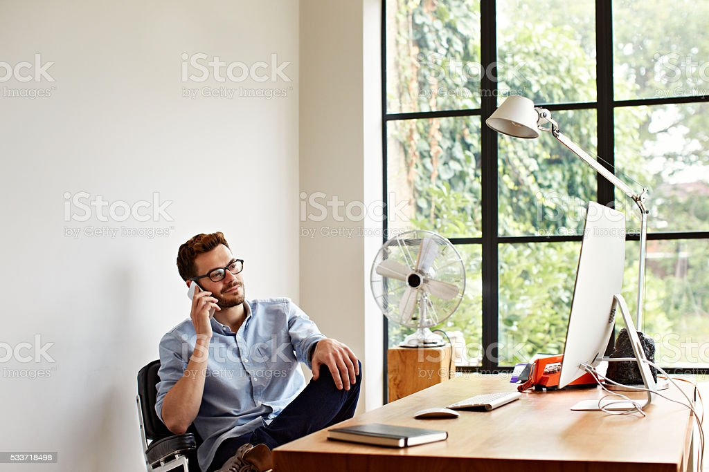 Building his business from home stock photo