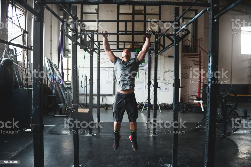 Building his muscles stock photo