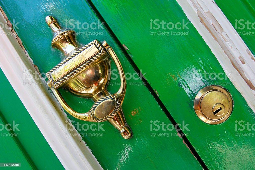 Building house door green gold handle lock key Bokaap Cape Town stock photo