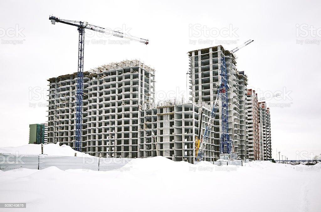 building houses new district winter, crane construction site stock photo