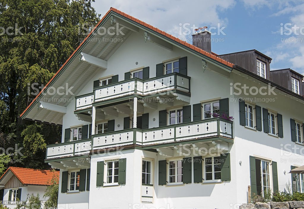 Building in bavarian look with green balcony royalty-free stock photo