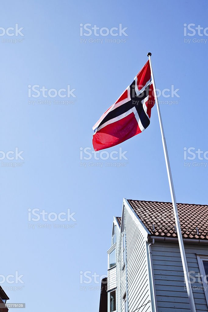 Building in Bergen with a Norwegian flag stock photo